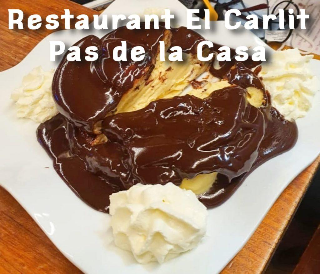 Profiteroles, sauce chocolat et chantilly avec glace vanille Restaurant Pas de la Casa El Carlit de Neu Steak House